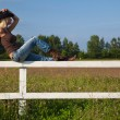 Young cowgirl sitting on a fence — Stock Photo #4022383