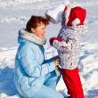 Mother and daughter in winter park — Stock Photo