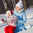Stock Photo: Mother and daughter in winter park