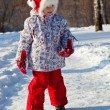 Little girl walking in a winter park — Stock Photo