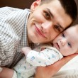 Baby and father - Foto Stock