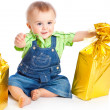 Baby with gifts — Stock Photo