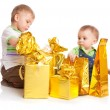 Stock Photo: Two boys with gifts