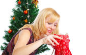 Girl near Christmas fir tree — Stock Photo