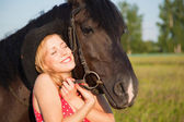Young blond woman with horse — Stock Photo