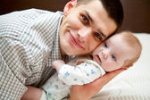 Baby and father — Stock Photo