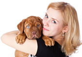 Young girl with puppy of Dogue de Bordeaux (French mastiff) — Stock Photo