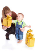 Mother and little boy with gifts — Stok fotoğraf