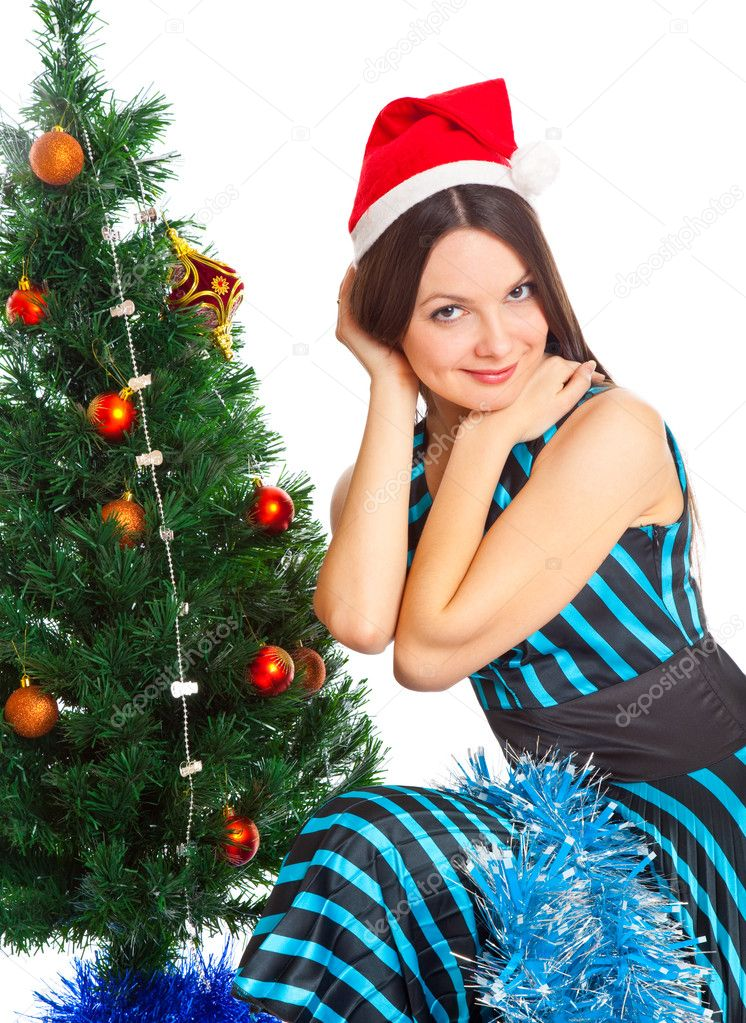 Girl near Christmas fir tree. Isolated on white — Stock Photo #4020775