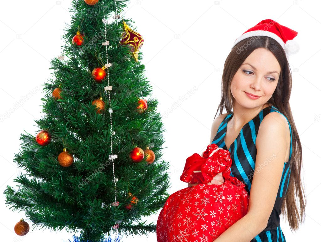 Girl near Christmas fir tree. Isolated on white — Stock Photo #4020778