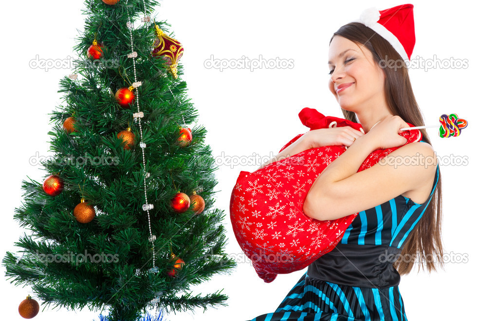 Girl near Christmas fir tree. Isolated on white — Stock Photo #4020784