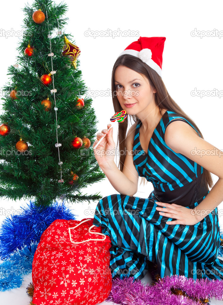 Girl near Christmas fir tree. Isolated on white — Stock Photo #4020786