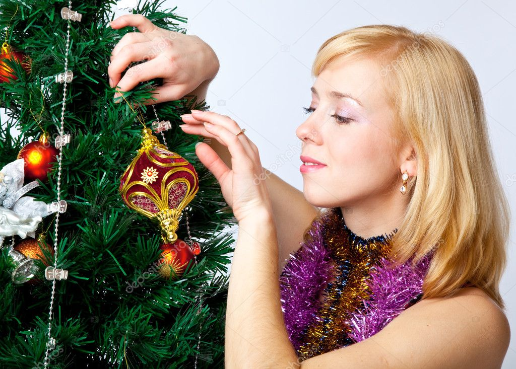 Girl near Christmas fir tree on gray background — Stok fotoğraf #4020805