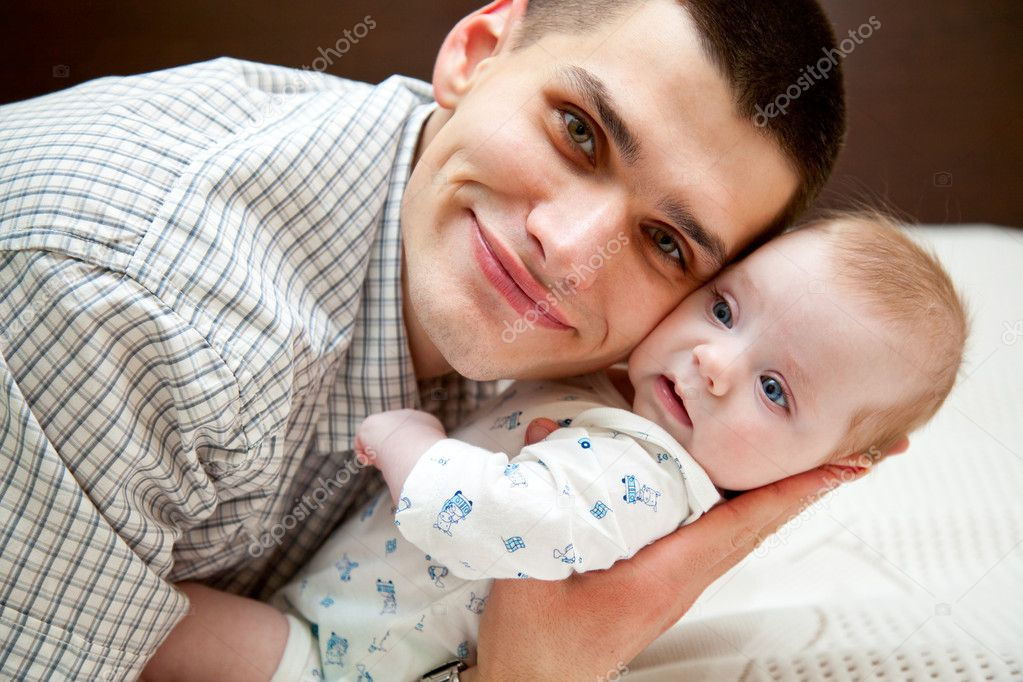 Adorable baby and father in home — Stock Photo #4027584