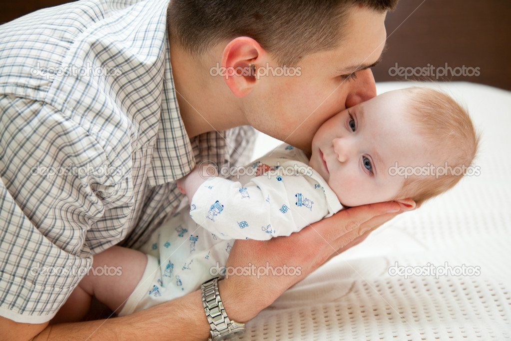 Adorable baby and father in home — Stock Photo #4027588