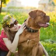 Young girl and her dog — Stock Photo #4030109