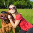 Young girl and her dog — Stock Photo #4030184