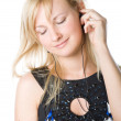 A beautiful young girl listening to music on her mp3 player — Stock Photo #4030939