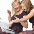Two girls reading magazine — Stock Photo