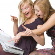 Stock Photo: Two girls reading magazine