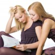 Two girls reading magazine — Stock Photo #4031016