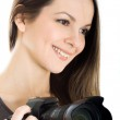 Portrait of a beautiful young woman with camera — Stock Photo