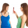 Two teenage girls photographing on mobile phone — Stock Photo #4031245