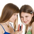Two pretty girls reading SMS on mobile phone — Stock Photo