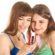 Two pretty girls reading SMS on mobile phone — Stock Photo #4031267