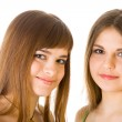 Two happy young girlfriends telling secret — Stock Photo