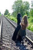 Two girls on railway — Stock Photo