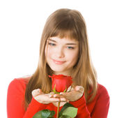 Young girl with rose — Stock Photo