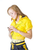 A sporty young girl listening to music on her mp3 player — Стоковое фото