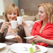 Two young women in cafe — Stock Photo