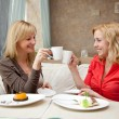 Two young women in cafe — Stockfoto