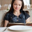 Young woman in restaurant - Stock Photo