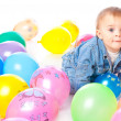 Little baby in balloons — Stock Photo