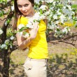 Beautiful girl in blossom orchard — Stock Photo