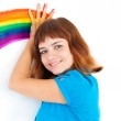 Red-haired girl draw rainbow by palm — Stock Photo #4076862