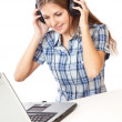Teen-girl listen to music in headphones with laptop — Stock Photo