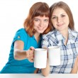 Royalty-Free Stock Photo: Two teen-girls are drinking tea