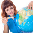 Red-haired girl is painting globe — Stock Photo