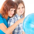 Two teen-girls are looking at globe — Stock Photo