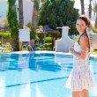 Young woman near the pool — Stock Photo