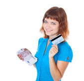 The red-haired young girl with a credit card and a bundle of ban — Stock Photo