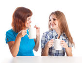 Two teen-girls are drinking tea — Stock Photo