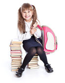 A girl is sitting on the books — Stock Photo