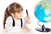 A girl is looking at the globe — Stock Photo