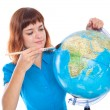 A girl is painting on the globe — Stock Photo #4225951