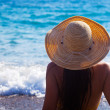 Stock Photo: A woman is looking to the sea